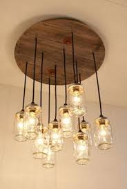 glass jar lighting. mason jar chandelier lighting upcycled wood i bet could make this glass