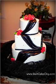 Salt Cake City Black Draping Red Roses Wedding Cake