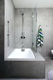pixels wide bathtub glass door concrete corner tub and shower doors