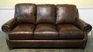 Living Room Dark Brown Leather Sofa With Arm And Back Also Nails