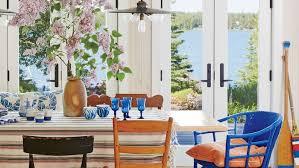 coastal dining room. Light Wood Walls, Painted Gray Floors, And Windowed French Doors Keep The Focus On Coastal Dining Room