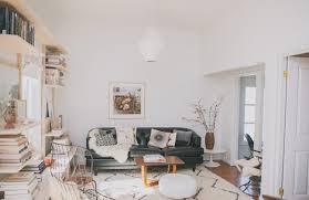 bohemian modern style living room decoratin ideas with black leather sofa