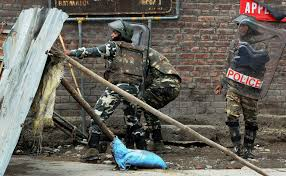 photo  security forces in action against protesters during a clash in srinagar curfew was clamped in