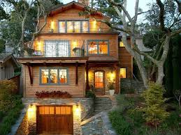 exterior accent lighting for home. craftsman exterior of home with stacked stone wall, barn garage accent lighting for g