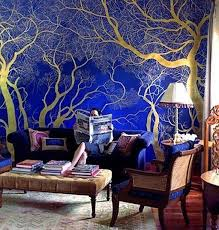 shiny gold painted tree on royal blue