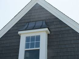 the siding on this home is prefinished 7 inch nichiboard cedar grain lap siding on the peak is prefinished nichiha sierra premium shake plus in the color