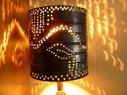 punched tin lighting. the design of punching lets light shine through in an intriguing pattern punched tin lighting
