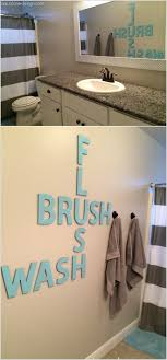 paint wood letters and create a crossword wall art on bathroom wall art decoration ideas with 10 creative diy bathroom wall decor ideas