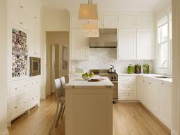 white l shaped cabinet and small island for amazing kitchen lighting design layout with contemporary pendant lamps