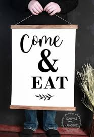 The best places for modern farmhouse artwork are living rooms, kitchen spaces, bathrooms, bedroom and not to mention hallways and laundry rooms. Wood Canvas Wall Hanging Kitchen Art Come Eat Farmhouse Sign