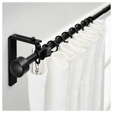 black ceiling mounted curtain rods with white grommet