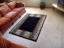 leopard print border area rug on black 5ft x 8ft