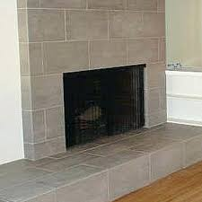 tile over brick fireplace tiling over a brick fireplace is easier than you might think diy tile over brick fireplace