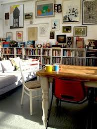 save art for a diffe wall above book display shelves makes it busier keeps some wall e clear gives eye place to rest blue couch would actually