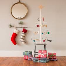 a small tree branch used as a stocking holder