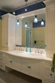 Kids bathroom; hollywood bath suite, white beadboard inset cabinets,  recycled glass terrazzo floors