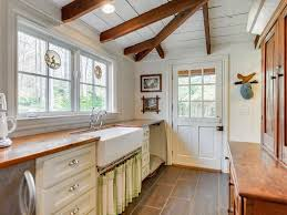 Country Kitchen Floors Country Kitchen With Exposed Beam By Mary Hayes Zillow Digs Zillow