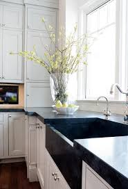 white kitchen cabinets with black a sink
