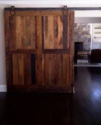 sliding barn doors made from reclaimed chestnut lumber for living space from reclaimed lumber