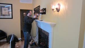 norwalk ct tv mounted over fireplace with all wires concealed img 1101