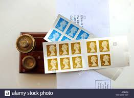British First 1st Class Postage Stamps Uk On A Letter Sitting On