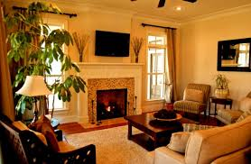 small living room with dark fireplace and tv on opposite walls hardwood floors images layout ideas facing each other adjacent diffe furniture