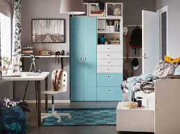 a contemporary turquoise grey and white children s bedroom with a white and light blue stuva
