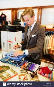 s clerk folding t shirt at checkout counter in clothing store s clerk folding t shirt at checkout counter in clothing store