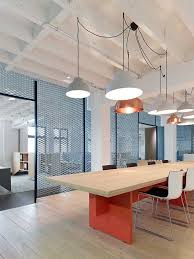 office lighting levels at work. great simple lighting pendants and interesting use of materials in porous wall. could more office levels at work