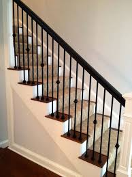 Jennifer Taylor Design- Custom Staircase -iron spindles - wood handrail -  wood newel post