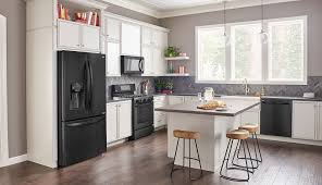 white kitchen cabinets and stainless steel appliances redesign lg matte black stainless steel embrace the dark