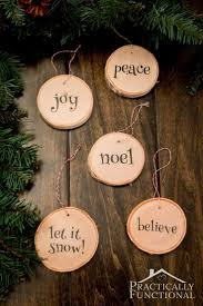 DIY Wood Slice Christmas Ornaments - Make your own wood slice ornaments!  Use wood slice coasters from a craft store if you don't have a small branch  to cut ...