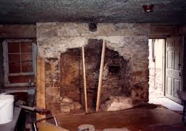 an old stone fireplace being opened up through removal of fireplaces historic fireplace restoration