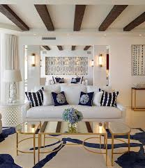 coastal inspired living room with coffee table in gold and