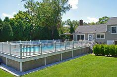 semi inground pool ideas. Beautiful Wooden Deck Built Around A Quest Oval Pool. #deck #pool #oval. Semi Inground Pool Ideas