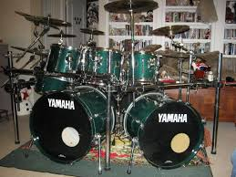 yamaha stage custom. my stage custom kit was purchased in 1997 i believe. it is made with 9 ply falkatta and the outer shell maple some had a outter layer of birch. yamaha