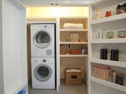 exciting small laundry room ideas with stacked washer dryer and open storage shelves