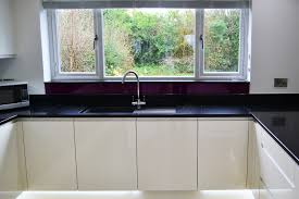 larissa white gloss handleless door with black mirror chip quartz worktop
