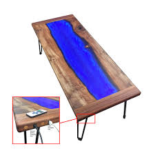 picture of led lit walnut and resin river coffee table that charges your phone