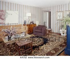 stock image 1970s living room striped wallpaper oriental carpet couch chair coffee table fotosearch