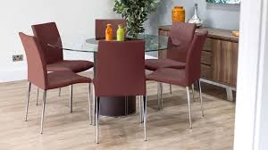 modern red dining chairs with round glass dining table