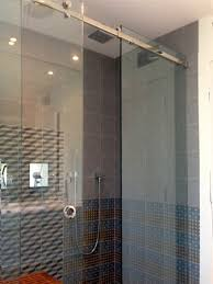 frameless corner sliding shower glass enclosure with one movable panel in the middle and fixed panels