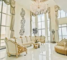 living living room with large crystal chandelier high ceiling