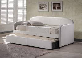 white leather daybed with sliding bed added by grey fur rug on grey
