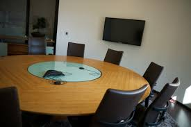 boardroom table bamboo round boardroom table with glass insert housing cables under glass with