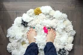 how to make a pom pom rug this soft scrumptiously squishy diy pom pom