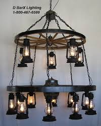ww026 60 10 48 5 double tier rustic wagon wheel chandelier light fixture with hanging lantern lights 60 inch diameter wheel on the bottom with 10