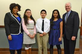 honors three middle school students in mlk essay contest