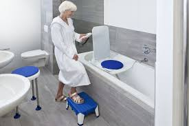 disabled baths showers. a woman using disabled bath baths showers