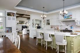 Inspiration for a large timeless l-shaped dark wood floor eat-in kitchen  remodel